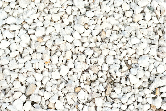 Drainage systems from small pebbles. Garden drainage for plants and trees. White stones for roads and flower beds.