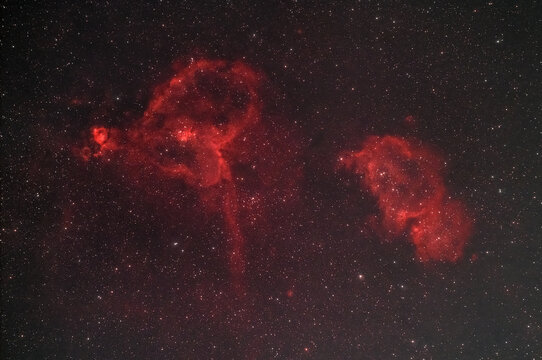 The Heart (IC 1805) and Soul (IC 1848) nebulae , two hydrogen alpha rich nebulae  glowing in the night sky