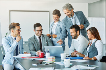 Photo sur Plexiglas Dinosaurs young business people meeting office teamwork group success corporatye discussion senior laptop