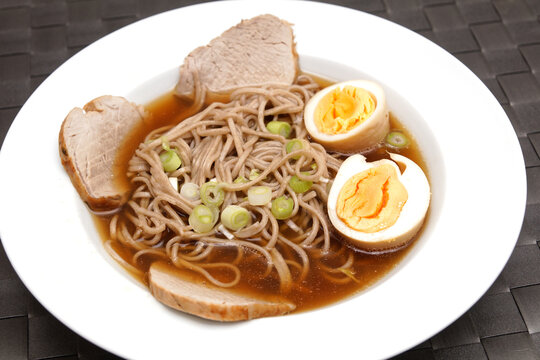 ramen soup with egg, noodles and beef