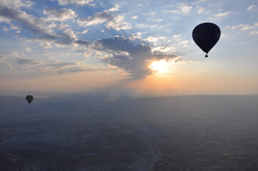 Silhouette of hot air balloons at sunrise over Cappadocia, Turkey