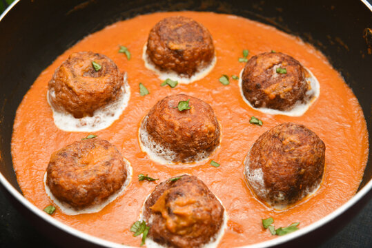 Malai Kofta Curry Mughlai or Haryanvi style Methi  in white cream, popular indian vegetarian main course served with Chapati Or Roti. Cheese ball dipped in creamy gravy Classic North Indian side dish