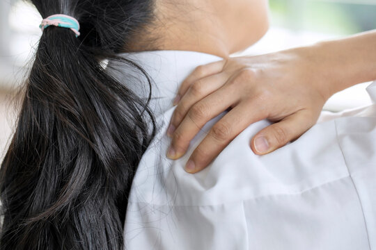 Health care and medical concept: Closeup woman neck and shoulder pain and injury.