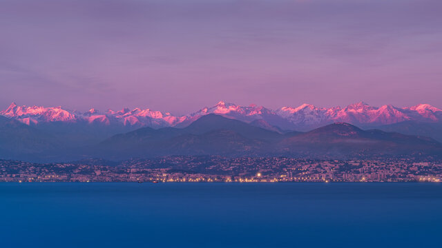 View on the snowing mounts and cities on the seaside