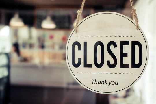Closed. coffee cafe shop text on vintage sign board hanging on glass door in modern cafe shop reopen after coronavirus quarantine is over in restaurant ready to service, small business owner concept
