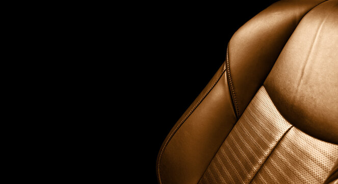 Modern Luxury car brown leather interior. Comfortable orange leather seats with stitching. Perforated leather interior