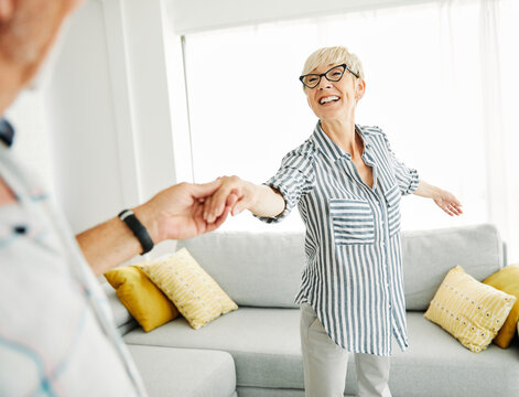 dancing senior woman home love couple happy man together retirement smiling lifestyle home fun elderly