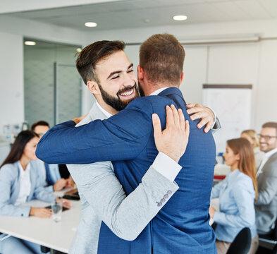 hug hugging coworker love partner office business happy relationship