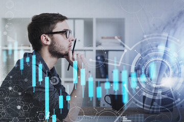 Businessman in glasses in office, financial graph