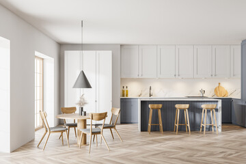 Printed kitchen splashbacks London Modern white and gray kitchen with dining table and bar