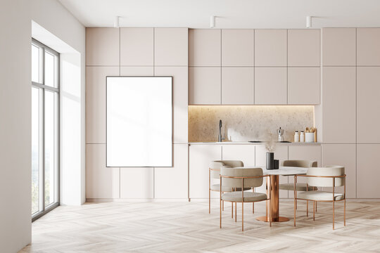 Stylish white and gray kitchen with dining table and poster