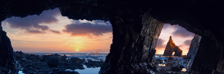 Sunrise from inside the cave of Campiecho in Asturias, Spain.