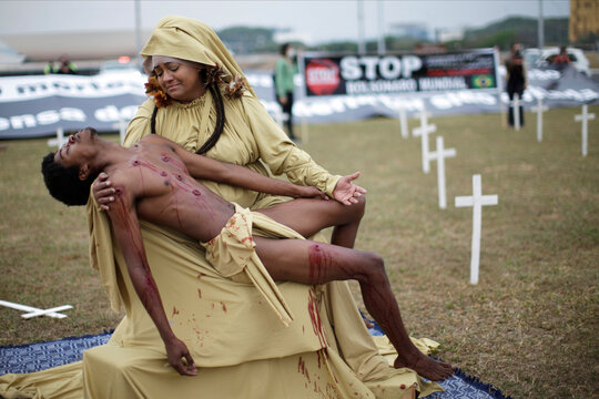Actors Lidi Leao and Daniel Pereira perform during a protest against Brazil's President Jair Bolsonaro and racism, in Brasilia