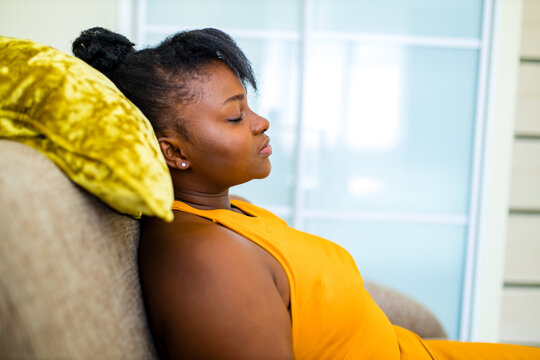 latin brazilian woman feeling calm relaxing in living room on meditation