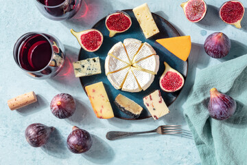 Cheese and wine tasting, cheese platter with figs, a flat lay, top shot