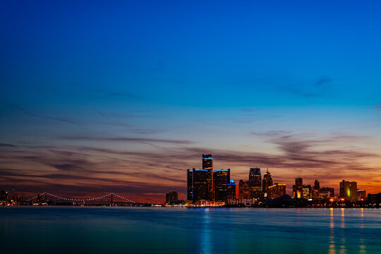 Night view of Detroit downtown skyscrapers and river from sunset point of Belle Isle, Michigan USA