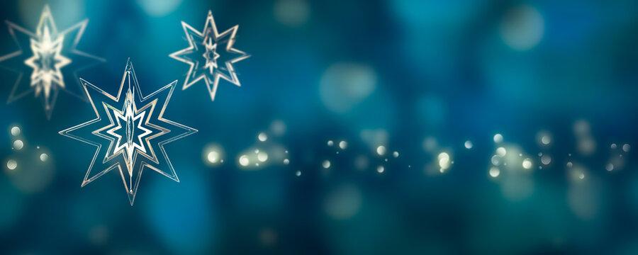 weihnachtsstern als dekoration vor abstraktem hintergrund