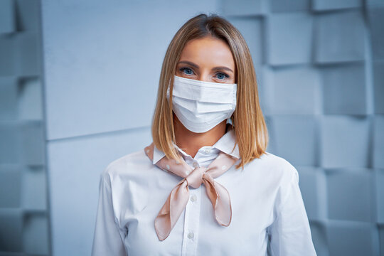 Female receptionist wearing face mask
