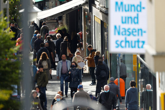 People wearing face masks are pictured at Schloss Strasse shopping street, amid the coronavirus disease (COVID-19) outbreak, in Berlin