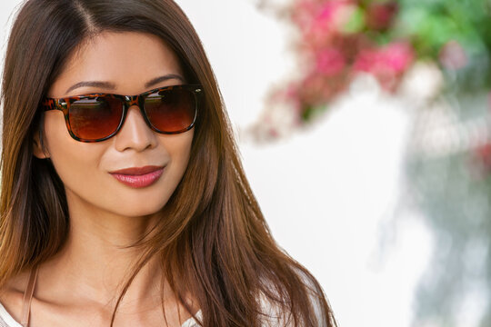 Beautiful Asian Girl or Young Woman Wearing Sunglasses Outside in Summer