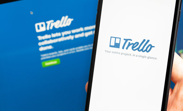 Trello logo app on the screen smartphone and notebook closeup. Trello is a cloud-based project management software for small teams. Moscow, Russia - July 28, 2020