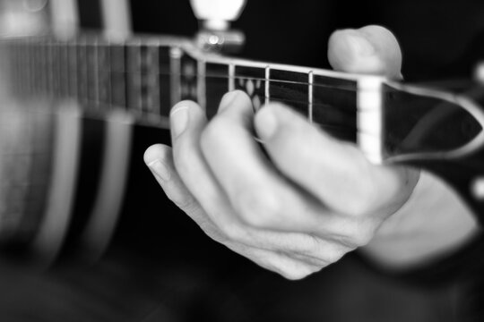 Close up of hands playing the banjo