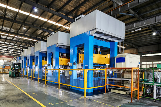 Stamping machines in large factories