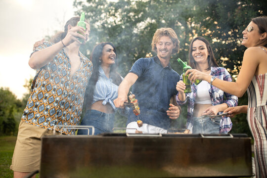 Young people smoking some barbeque