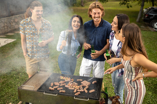 Young people roasting some barbeque meat