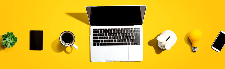 Printed kitchen splashbacks London Laptop computer with a piggy bank and office objects