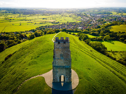 Glastonbury Tor near Glastonbury in the English county of Somerset, topped by the roofless St Michael's Tower, UK