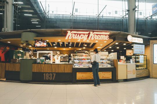 Bangkok, Thailand - October 10, 2020 : Exterior view of Krispy Kreme Doughnut Shop at Suvarnabhumi airport