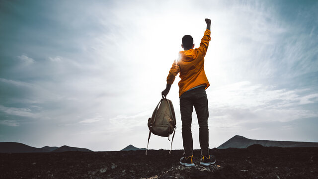 Success achievement silhouette - Man celebrating with arms up raised outstretched hiking mountains - Sport and business concept.