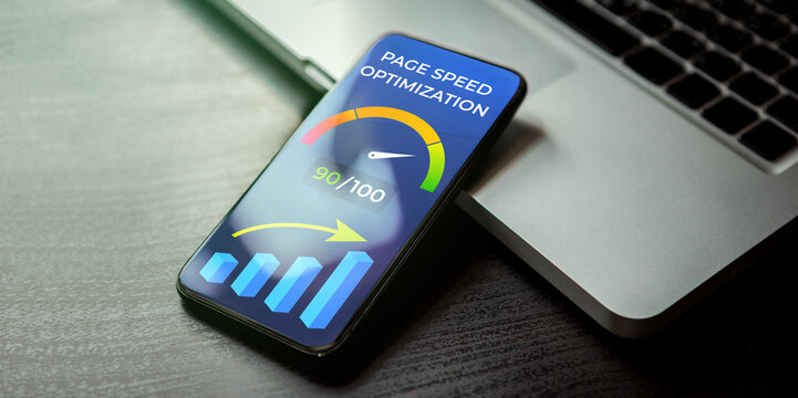 Mobile Page Speed Optimization concept. Website Loading Time image for internet SEO. Mobile phone lying on a black wooden table next to the laptop and on the screen accelerometer with high values