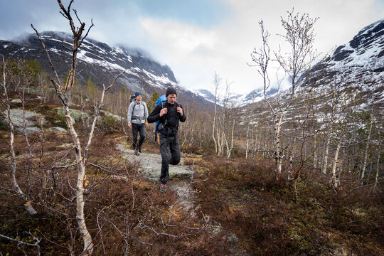 Two males hiking in the mountains of Norway.