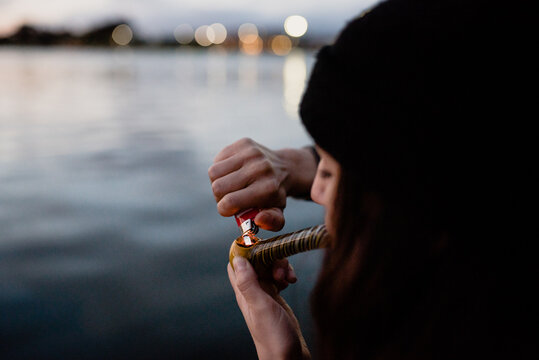 Woman smoking marijuana out of a pipe