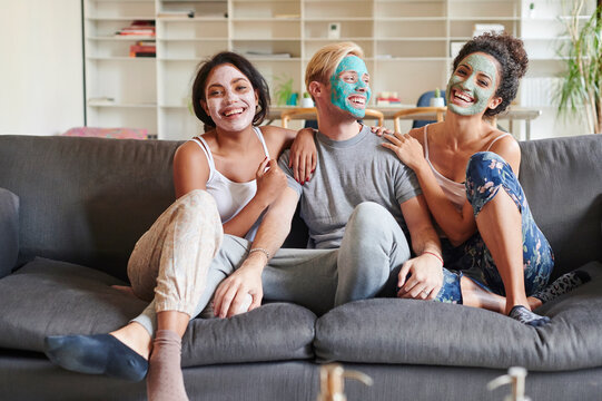Friends with face masks at home