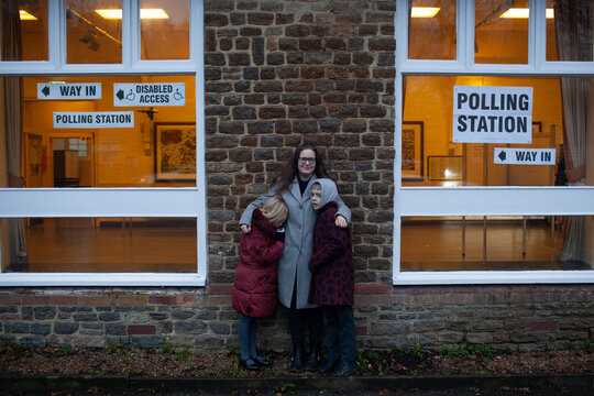 Voted. A woman stands outside a UK polling station.