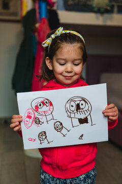 Little girl showing cute doodles