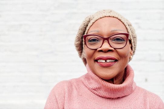 Smiling senior woman standing outside