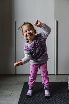 Little girl dancing in morning