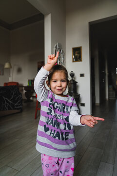 Funny girl pointing in different directions