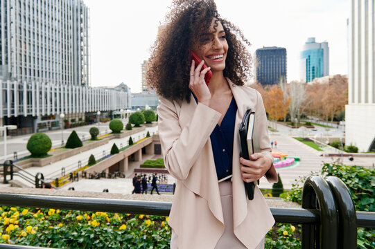 Smiling businesswoman talking on a cellphone