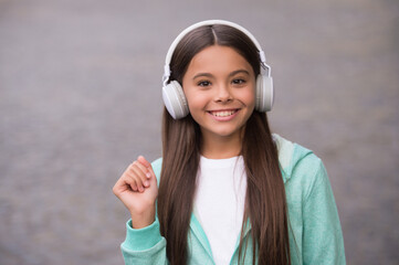 happy child wear headphones. listen to music. back to school. online private education. smiling kid...