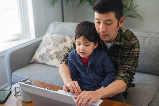 Dad and little kid on computer