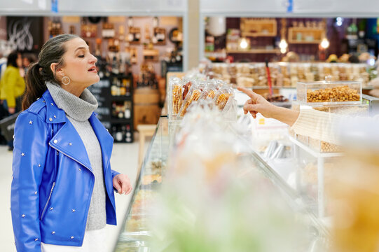 Mature woman browsing goods in a grocery store