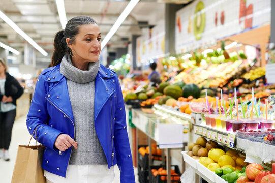 Mature woman shopping for fresh fruit