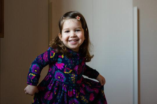 Happy girl in floral dress dancing