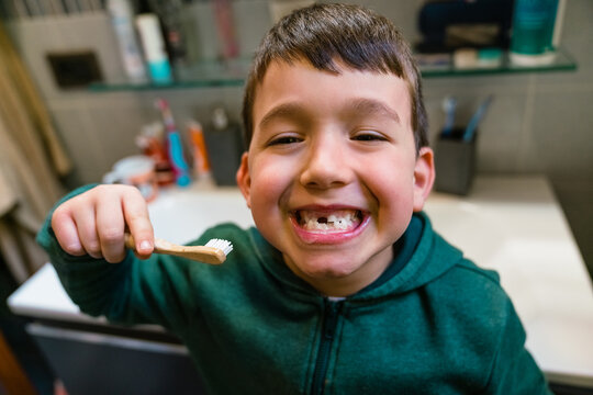 Happy boy with toothbrush showing teeth