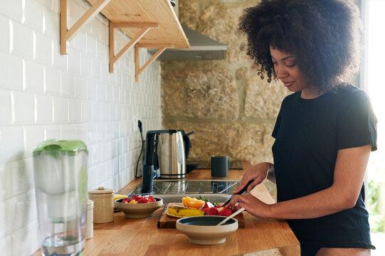 Smiling woman making a healthy breakfast